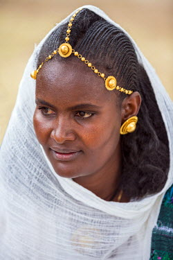 ETH3201 Ethiopia, Tigray Region, Axum.  An attractive young Ethiopian woman with distinctive hairstyle and jewellery.