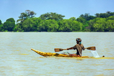 ETH3211 Ethiopia, Lake Tana, Dek Island.  A fisherman off Dek Island in a traditional reed boat, called a tankwa.