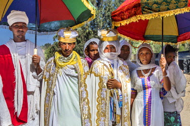 ETH3223 Ethiopia, Amhara Region, Lalibela.  A bride and bridegroom in traditional attire are escorted by friends and relatives on their wedding day.