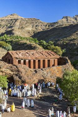 ETH3224 Ethiopia, Amhara Region, Lalibela, Genetta Maryam.  A open-air church service outside the beautiful ancient rock-hewn church of Genetta Maryam, an hour's drive from Lalibela.