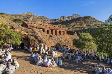 ETH3225 Ethiopia, Amhara Region, Lalibela, Genetta Maryam.  A open-air church service outside the beautiful ancient rock-hewn church of Genetta Maryam, an hour's drive from Lalibela.