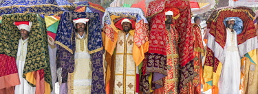 ETH3297 Ethiopia, Amhara Region, Lalibela. Priests each carry a tabot (a replica of the Ark of the Covenant) on their heads during the annual Timkat festival of the Ethiopian Orthodox Church which celebrates...