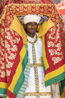 ETH3301 Ethiopia, Amhara Region, Lalibela. A priest carries a tabot (a replica of the Ark of the Covenant) on his head during the annual Timkat festival of the Ethiopian Orthodox Church which celebrates Epiph...