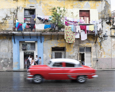 CUB1566AW classic american car passes old buildings, Havana, la habana, Cuba
