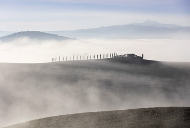 ITA10138AW House in the mist, Val d'Orcia; Tuscany; Italy