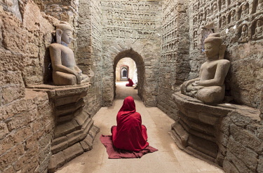 MYA2088AW Monks pray in temple, Mrauk U, Rakine State, Burma, Myanmar
