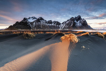 ICE4027AW Stokksnes, Hofn, East Iceland, Iceland. Vestrahorn mountain and the black sand dunes at sunset.