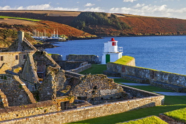 IRL0554 The Lighthouse (by Robert Reading), Soldiers' Quarters, Magazine and the seaward bastions of the 17th Century Charles Fort, looking toward the Celtic Sea, with Kinsale Boatyard in the background, Kins...