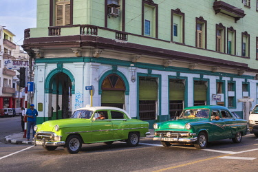 CB02638 Cuba, Havana, Classic American cars passing by Bar San Juan