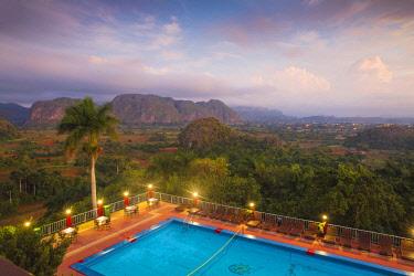 CB02658 Cuba, Pinar del Río Province, Vinales, View over Hotel Horizontes Los Jazmines swimming pool to Vinales valley