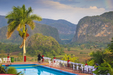 CB02664 Cuba, Pinar del Río Province, Vinales, View over Hotel Horizontes Los Jazmines swimming pool to Vinales valley - set up for a wedding party