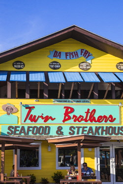 BA01406 Caribbean, Bahamas, Providence Island, Nassau, Arawak Cay, Nassau's famous Fish Fry - a group of restaurants and bars serving up traditional, fresh Bahamian food and drink