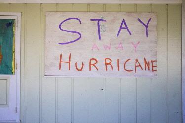 BA01253 Bahamas, Abaco Islands, Man O War Cay, Sign saying Stay away Hurricane