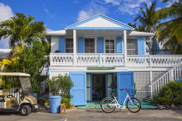 BA01233 Bahamas, Abaco Islands, Elbow Cay, Hope Town, Bay Street, Bay Street Tellin - a harbor front home