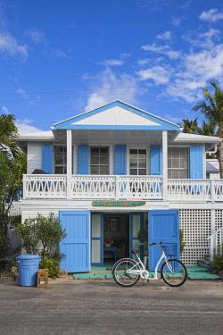 BA01234 Bahamas, Abaco Islands, Elbow Cay, Hope Town, Bay Street, Bay Street Tellin - a harbor front home
