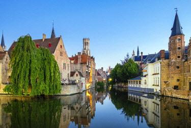 BEL1771AWRF Belgium, West Flanders (Vlaanderen), Bruges (Brugge). Belfort van Brugge and medieval buildings on the Dijver canal from Rozenhoedkaai at dawn.