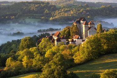 FRA9676AW Curemonte labelled l'un des plus beaux villages de France (most beautiful villages in France) in the morning mist, Correze, Nouvelle-Aquitaine, France