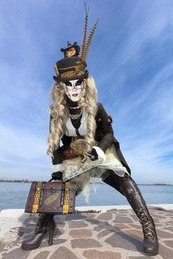 ITA10170AW Woman in Steampunk costume posing during Carnival on Burano Island, Venice, Veneto, Italy
