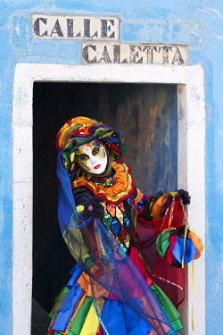 ITA10180AW Colourful costume worn during the Venice Carnival on the island of Burano, Venice, Veneto, Italy