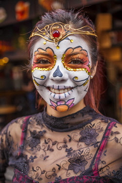 MEX1814AW Young girl with face make-up like a mask with day of the dead theme, Mexico City, Mexico.