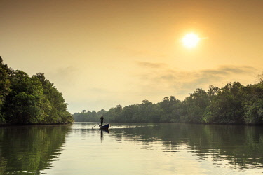 CMB1587AW Asia, South East Asia, Cambodia, Cardamom mountains, Chi Phat, boatman on the Piphot river at sunrise (MR)