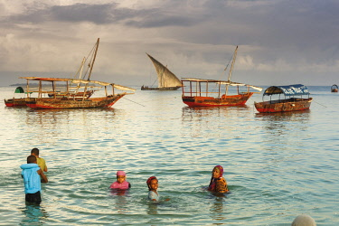HMS2684879 Tanzania, Zanzibar, Zanzibar City, Stone Town, listed as World Heritage by UNESCO, family swimming in the marina at sunset