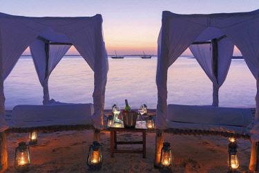 HMS2684936 Tanzania, Zanzibar, Kendwa, Kilindi Hotel, romantic lounge chairs on the shore at dusk