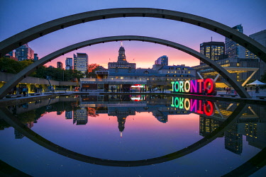 CA03294 Canada, Ontario, Toronto, Toronto Sign in Nathan Phillips Square by the City Hall, dusk