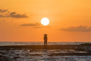 DMR0132AW Saona Island, East National Park (Parque Nacional del Este), Dominican Republic, Caribbean Sea. Woman admiring the sunset on the beach (MR)