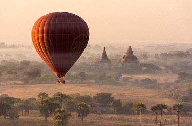 MYA2119AW A hot-air balloon flying over pagodas in Bagan, Myanmar
