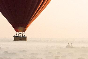 MYA2123AW Hot air balloon flying over pagodas in Bagan, Myanmar