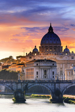 ITA10351AW Italy, Rome, St. Peter Basilica at sunset reflecting on Tevere river