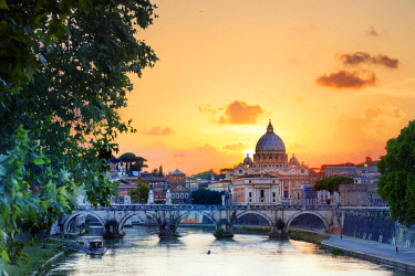 ITA10358AWRF Italy, Rome, St. Peter Basilica at sunset reflecting on Tevere river