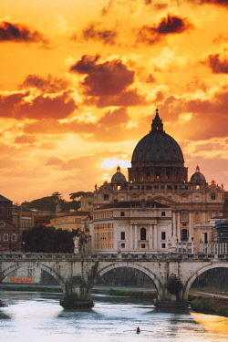 ITA10359AWRF Italy, Rome, St. Peter Basilica at sunset reflecting on Tevere river