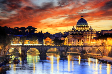 ITA10361AW Italy, Rome, St. Peter Basilica by night reflecting on Tevere river