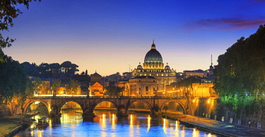 ITA10362AW Italy, Rome, St. Peter Basilica by night reflecting on Tevere river
