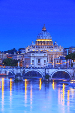 ITA10368AW Italy, Rome, St. Peter Basilica by night reflecting on Tevere river