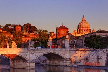 ITA10372AWRF Italy, Rome, St. Peter Basilica at sunrise reflecting on Tevere river
