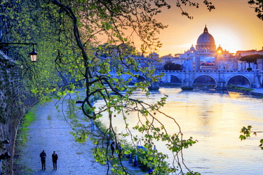ITA10414AW Italy, Rome, St. Peter Basilica at sunset reflecting on Tevere river