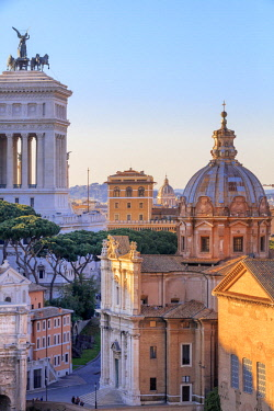 ITA10453AW Italy, Rome, Roman Forum and Altare della Patria monument at sunset