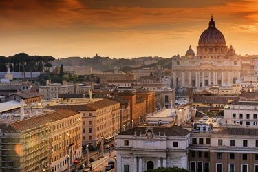 ITA10486AW Italy, Rome, St. Peter Basilica and Via della Conciliazione elevated view at sunset