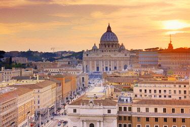 ITA10489AWRF Italy, Rome, St. Peter Basilica and Via della Conciliazione elevated view at sunset