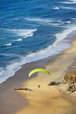 POR9396AW Paragliding over Cordoama beach. Algarve, Portugal