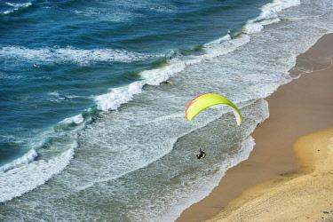 POR9399AW Paragliding over Cordoama beach. Algarve, Portugal
