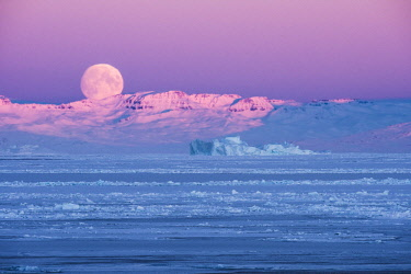 GRN1353 Moon set and sunrise over the Inuit settlement of Oqaatsut, West Greenland