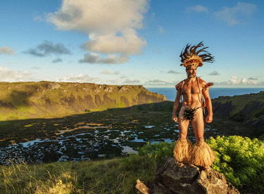 CHI10750AW Native Rapa Nui man in tradititional costume on the rim of the Rano Kau Volcano, Easter Island, Chile
