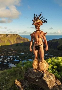 CHI10751AW Native Rapa Nui man in tradititional costume on the rim of the Rano Kau Volcano, Easter Island, Chile