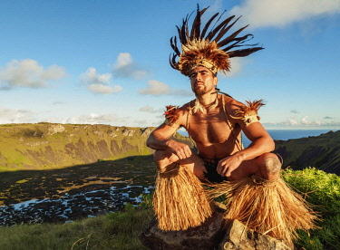 CHI10755AW Native Rapa Nui man in tradititional costume on the rim of the Rano Kau Volcano, Easter Island, Chile