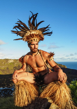 CHI10758AW Native Rapa Nui man in tradititional costume on the rim of the Rano Kau Volcano, Easter Island, Chile