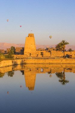 EG03415 Egypt, Luxor, Karnak Temple, Hot air balloons rise over the Sacred Lake
